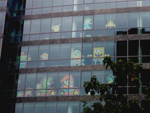 companies battle with post it art in their office windows the mary sue. Black Bedroom Furniture Sets. Home Design Ideas