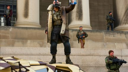 bane from the dark knight rises holding a pic of harvey dent.