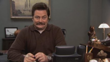 Ron Swanson slight smile and eyebrow raise in Parks and Recreation