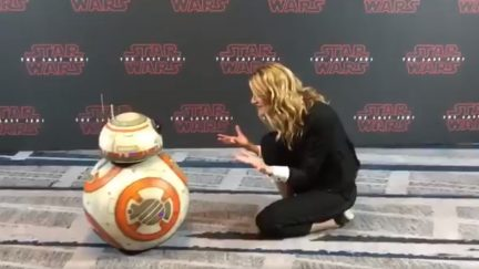 image: screencap Laura Dern and BB-8 at a press conference for Star Wars: The Last Jedi