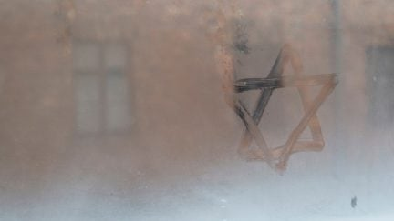 Auschwitz, Lesser Poland / Poland - Feb 04 2018: Auschwitz Birkenau, Nazi concentration and extermination camp. Star of David painted by a visitor in the condensation of a window. Jewish