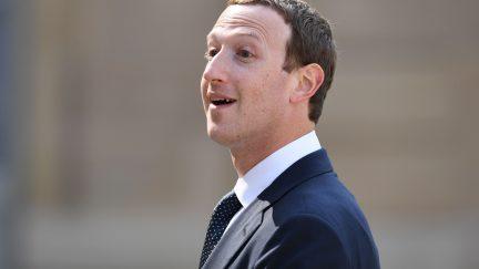 Mark Zuckerberg smiles looking into the distance