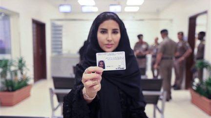Esraa Albuti displays her new driving license in Riyadh, Saudi Arabia