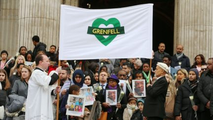 People gather on the steps after the Grenfell Tower National Memorial Service at St Paul's Cathedral in London, to mark the six month anniversary of the Grenfell Tower fire. PRESS ASSOCIATION Photo. Picture date: Thursday December 14, 2017. See PA story MEMORIAL Grenfell. Photo credit should read: Gareth Fuller/PA Wire
