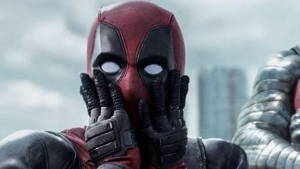 Deadpool gasping with his hands pressed to his face.