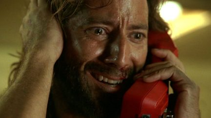 Desmond Hume (Henry Ian Cusack) calls home in LOST episode The Constant