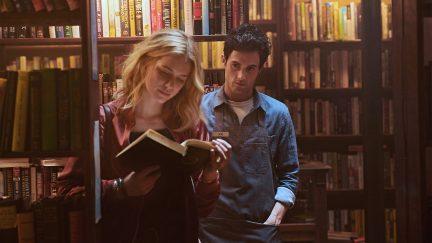 penn badgley as Joe looms behind elizabeth lail as Beck in Netflix's You