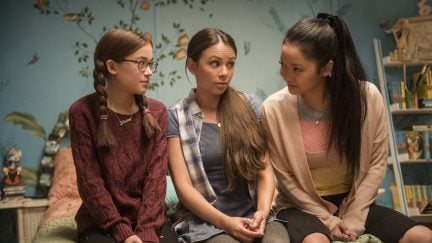 The Covey sisters sit together in To All the Boys I've Loved Before.