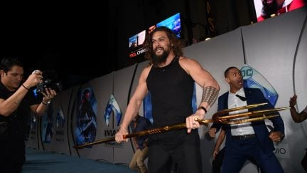HOLLYWOOD, CALIFORNIA - DECEMBER 12: Jason Momoa attends the premiere of Warner Bros. Pictures'
