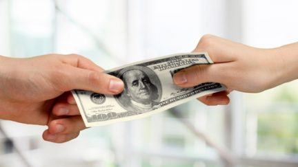 hands tugging on money