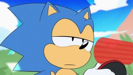 Sonic the Hedgehog looks at a message on an electronic device and seems disappointed.