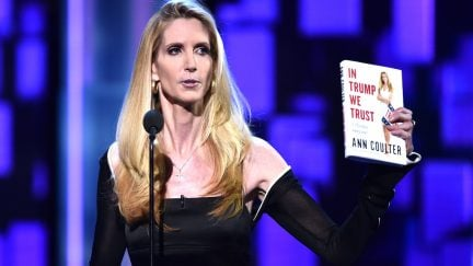 Ann Coulter speaks onstage at The Comedy Central Roast of Rob Lowe while holding her book 'In Trump We Trust'