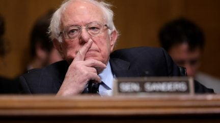bernie sanders sits on a senate committee hearing