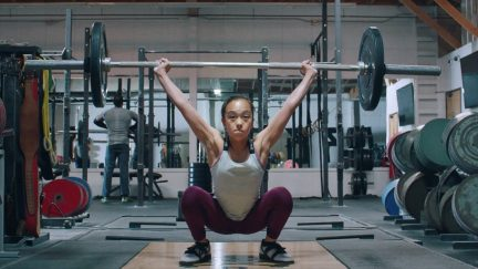 Young girl weight-lifts like a boss in Nike ad.