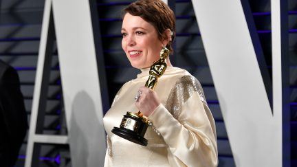 Olivia Colman holding her Oscar.