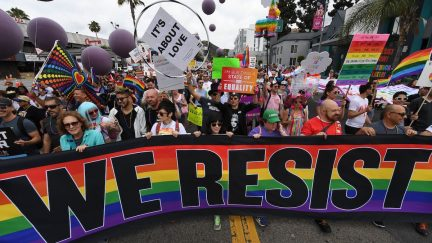 People march during the #ResistMarch at the 47th annual LA Pride Festival in Hollywood, California