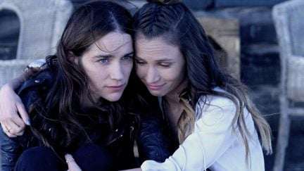 Melanie Scrofano and Dominique Provost-Chalkley in Wynonna Earp (2016)