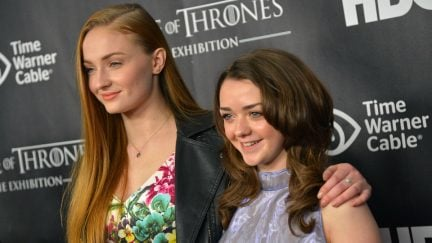 Actors Sophie Turner (L) and Maisie Williams attend 'Game Of Thrones' The Exhibition New York Opening at 3 West 57th Avenue on March 27, 2013 in New York City. (Photo by Mike Coppola/Getty Images)