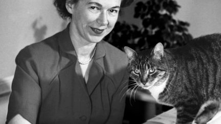 Young Beverly Cleary with her cat in black and white.
