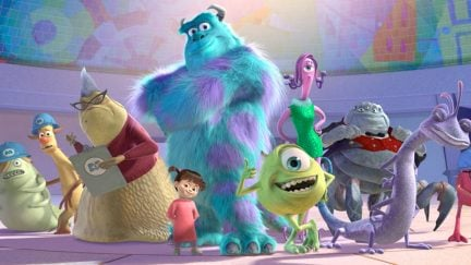The animated cast of Pixar's classic Monsters Inc. standing together.