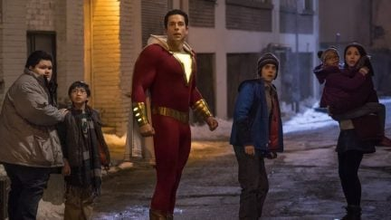 The family at the heart of DC's Shazam flees a villain in a still from the film.