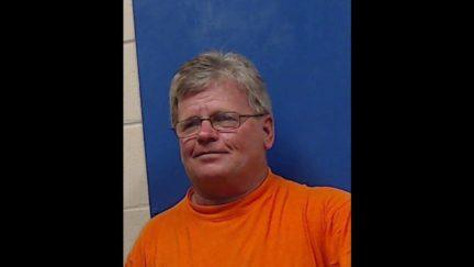 Rep. Doug McLeod poses for his mugshot.