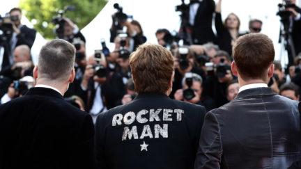 Elton John wearing Rocket Man jacket at Cannes Rocketman movie premiere.