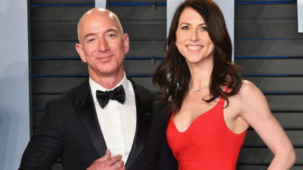 MacKenzie and Jeff Bezos pose on the Vanity Fair Oscar Party red carpet.