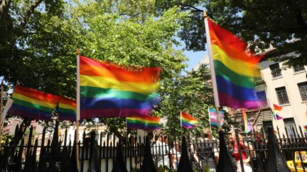 Rainbow pride flags fly outside the Stonewall Inn as crowds begin to gather to celebrate Pride Month on June 26, 2019 in New York City. Thousands of members of the LGBTQ community have been gathering outside of the historic gay bar in Greenwich Village to celebrate the 50th anniversary of riots at the inn, which many people consider the birth of the modern gay rights movement in America. (Photo by Spencer Platt/Getty Images)