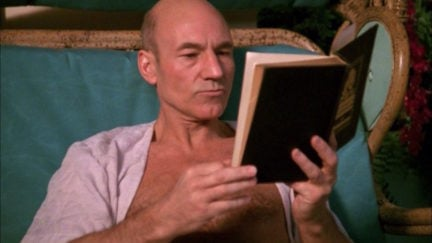 Captain Jean Luc Picard (Patrick Stewart) reads a book