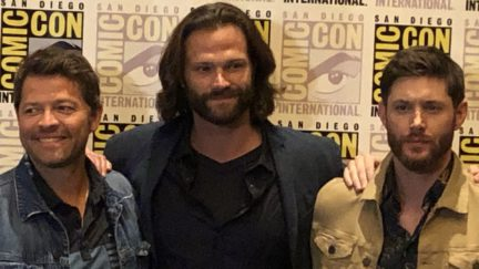 The CW's Supernatural cast posing for a photo at Comic-Con.