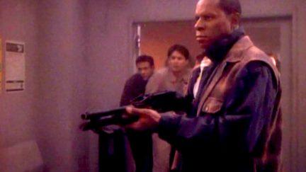 Avery Brooks as Benjamin Sisko, brandishing a shotgun in Star Trek: Deep Space Nine's