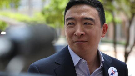Andrew Yang speaks to media outside.