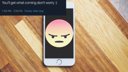 A threatening tweet and an angry emoji on a phone.