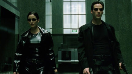 carrie-anne moss and keanu reeves as Trinity and Neo in The Matrix.