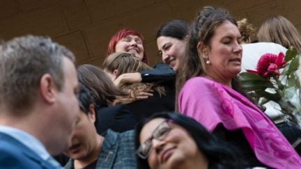 SYDNEY, AUSTRALIA - SEPTEMBER 26: Supporters of the bill to decriminalise abortion embrace outside NSW Parliament on September 26, 2019 in Sydney, Australia. After two weeks of debate, the Upper House of the NSW parliament passed legislation to decriminalise abortion on Wednesday night. The Reproductive Health Care Reform Bill 2019 - which was introduced by Independent Alex Greenwich and co-sponsored by 15 MPs from across all sides of politics - now returned to the NSW Legislative Assembly this morning to be passed into law. Rhe bill removes abortion from the Crimes Act and will regulate it as a medical procedure, with extra safeguards for abortions after 22 weeks' gestation. Abortions had been on the criminal code in NSW since 1900 with a penalty of 10 years in prison. (Photo by Brook Mitchell/Getty Images)
