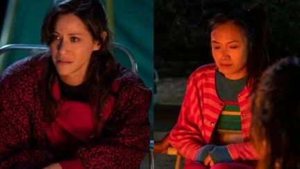 Melrose and Jenny sit around a campfire on Netflix's GLOW.