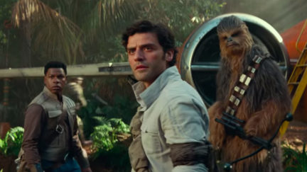Poe Dameron, Finn, and Chewbacca standing outside a ship in a jungle in Star Wars: The Rise of Skywalker trailer.