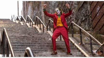 Joker dancing on the stairs.