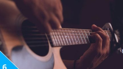 Guitar playing closeup.