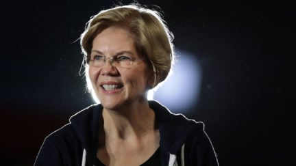 Elizabeth Warren smiles from the stage at a campaign event.