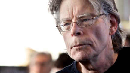 American author Stephen King poses for photographers on November 13, 2013 in Paris, before a book signing event dedicated to the release of his new book