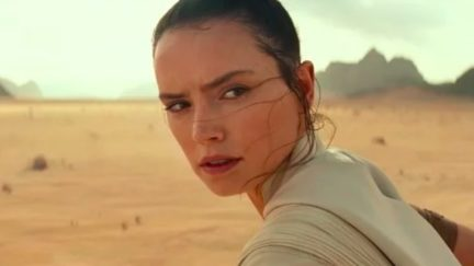 Rey looks over her shoulder in Star Wars: The Rise of Skywalker.