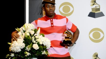 Tyler the Creator poses in the press room with the award for Best Rap Album for