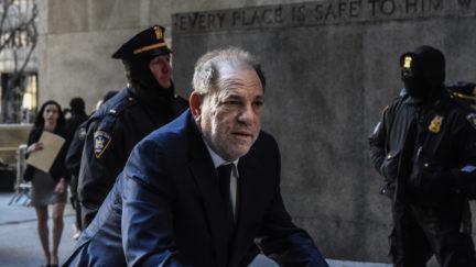 Harvey Weinstein arrives at New York City criminal court, hunched over a walker.