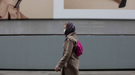 MILAN, ITALY - FEBRUARY 25: A woman, wearing a respiratory mask, walks in the streets on February 25, 2020 in Milan, Italy. Italy is the last country to be hit hard by the virus with 7 dead and more than 283 infected as of today. The spread marks Europe's biggest outbreak, prompting the Italian Government to issue draconian safety measures. (Photo by Emanuele Cremaschi/Getty Images)