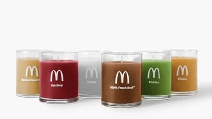 A set of sox candles sceneted like the indgrdients of a quarter pounder from mcdonalds