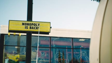Monopoly is back sign in front of a mcdonalds