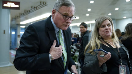 WASHINGTON, DC - JANUARY 23: Sen. Richard Burr (R-NC) speaks with a reporter as he walks through the Senate subway before the impeachment trial of President Donald Trump resumes at the U.S. Capitol on January 23, 2020 in Washington, DC. Democratic House managers will continue their opening arguments on Thursday as the Senate impeachment trial of President Donald Trump continues. (Photo by Drew Angerer/Getty Images)