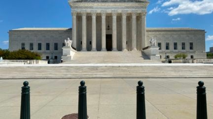 The US Supreme Court is seen amid the coronavirus pandemic on April 15, 2020 as stay at home order has been extended in Washington, DC until May 15. - Global stocks sank Wednesday as COVID-19 infects the global economic outlook, while oil prices slumped as OPEC-led output cuts were deemed insufficient to soak up a supply glut. (Photo by Daniel SLIM / AFP) (Photo by DANIEL SLIM/AFP via Getty Images)